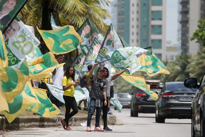 Supporters of Jair Bolsonaro, far-right lawmaker and presidential candidate of the Social Liberal Party (PSL), attend an elec