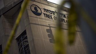 Police tape is seen on October 28, 2018 outside the Tree of Life Synagogue after a shooting there left 11 people dead in the Squirrel Hill neighborhood of Pittsburgh on October 27, 2018. - A man suspected of bursting into a Pittsburgh synagogue during a baby-naming ceremony and gunning down 11 people has been charged with murder, in the deadliest anti-Semitic attack in recent US history. The suspect -- identified as a 46-year-old Robert Bowers -- reportedly yelled 'All Jews must die' as he sprayed bullets into the Tree of Life synagogue during Sabbath services on Saturday before exchanging fire with police, in an attack that also wounded six people. (Photo by Brendan Smialowski / AFP)        (Photo credit should read BRENDAN SMIALOWSKI/AFP/Getty Images)