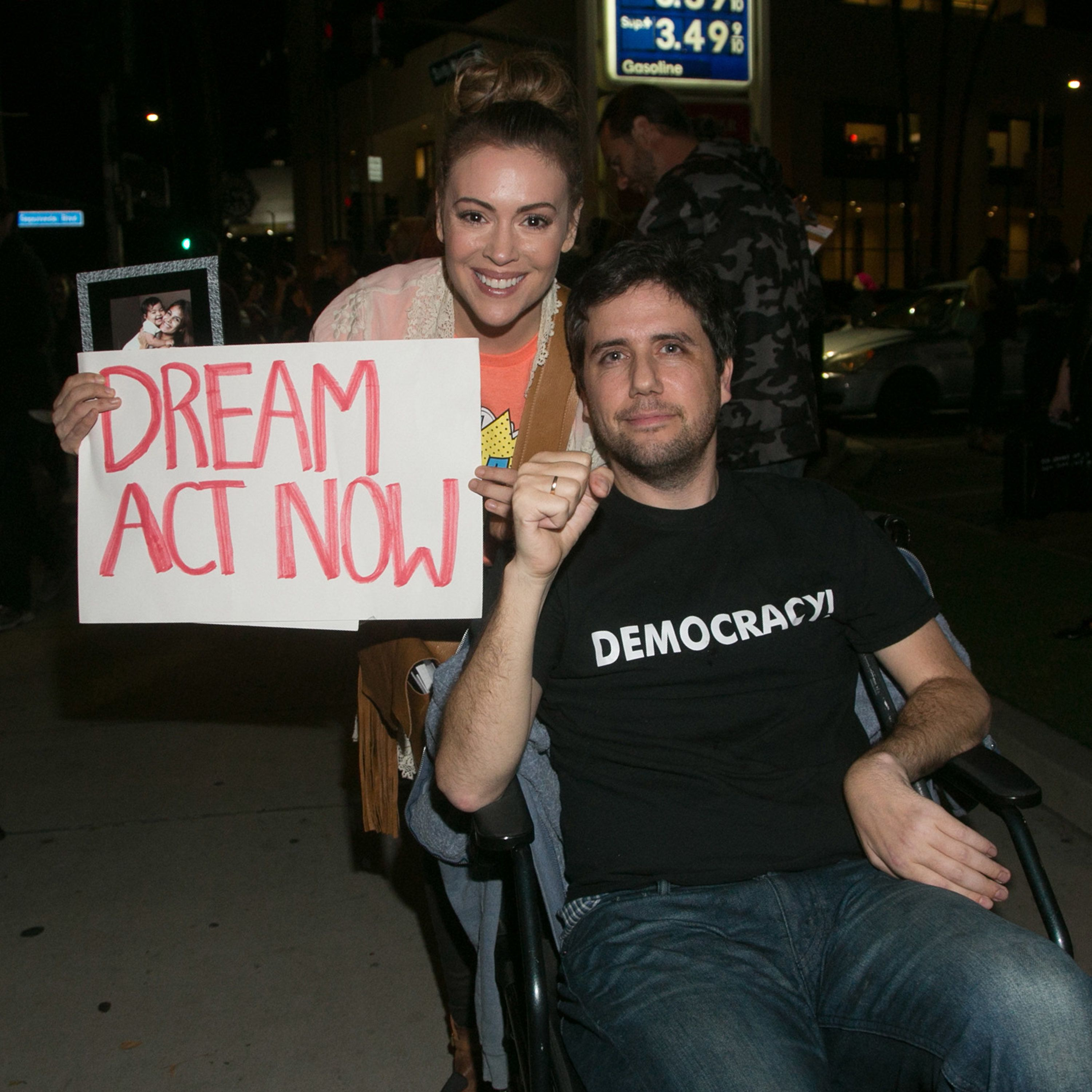 Ady Barkan, seated in a wheelchair, attends a rally for the Dream Act in Los Angeles in January 2018. Alyssa Milano, an actre
