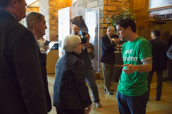 Ady Barkan speaks to Federal Reserve Chairwoman Janet Yellen during the inaugural Fed Up protest in Jackson Hole, Wyoming, on