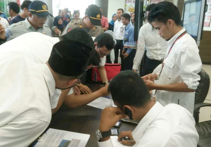 Lion Air officials check the passenger list of flight JT610.