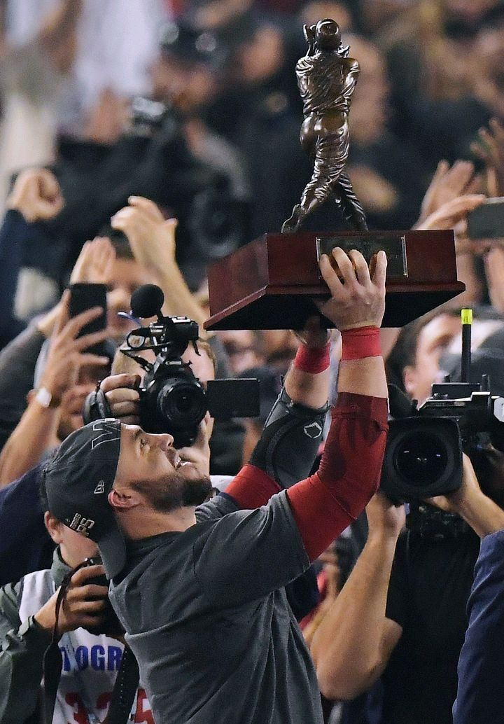 Boston Red Sox's Steve Pearce holds the MVP trophy after Game 5 of baseball's World Series against the Los Angeles Dodgers on