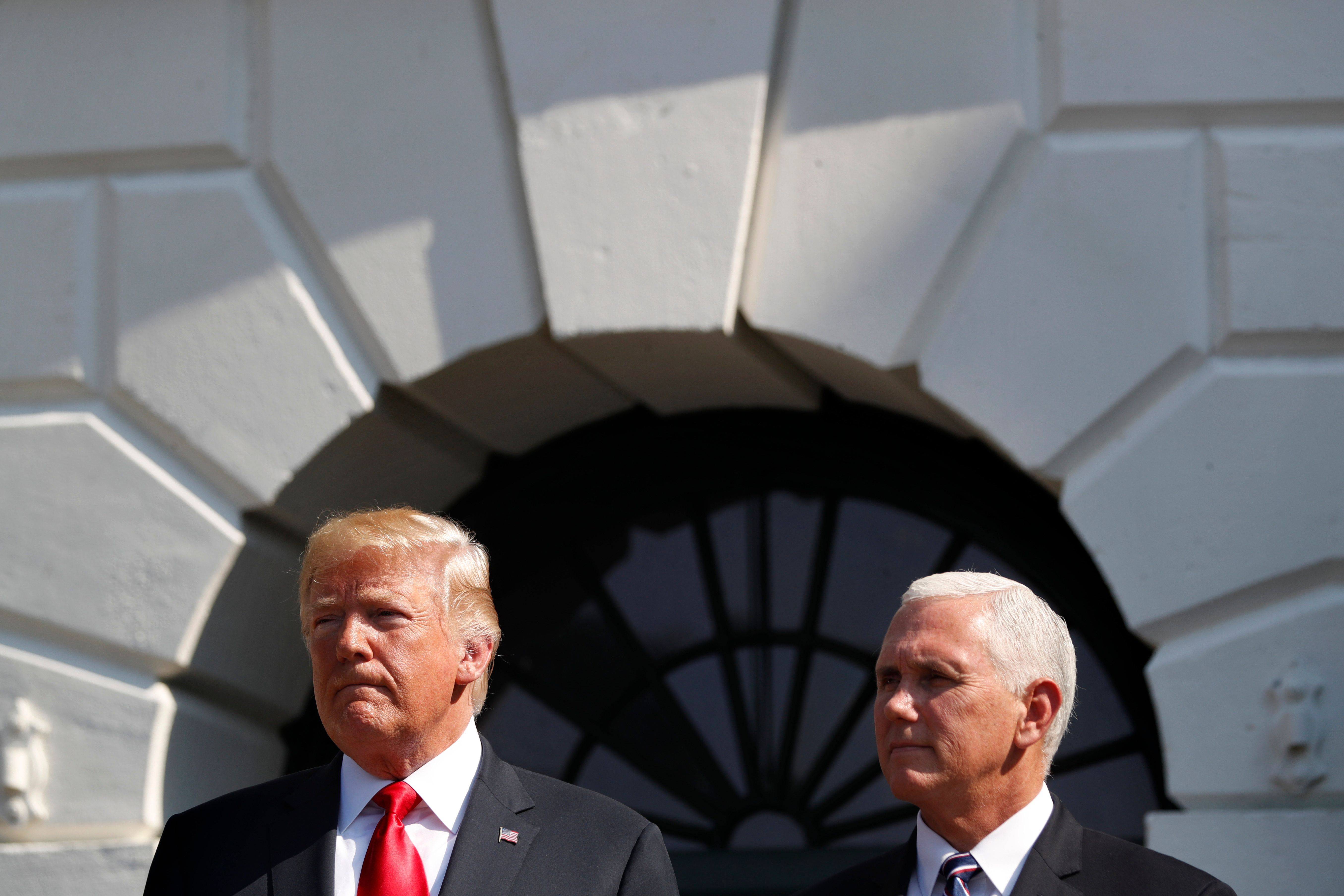 President Donald Trump, left, stands with Vice President Mike Pence, after delivering remarks on the economy from the South Lawn of the White House, Friday, July 27, 2018, in Washington. (AP Photo/Jacquelyn Martin)