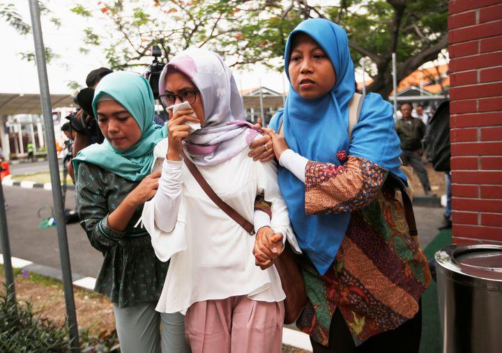 Relatives of passengers arrive at a crisis center located at Soekarno Hatta Internationalairport near Jakarta