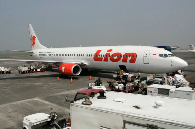 a Lion Air passenger jet is parked on the tarmac at Juanda International Airport in Surabaya, Indonesia....