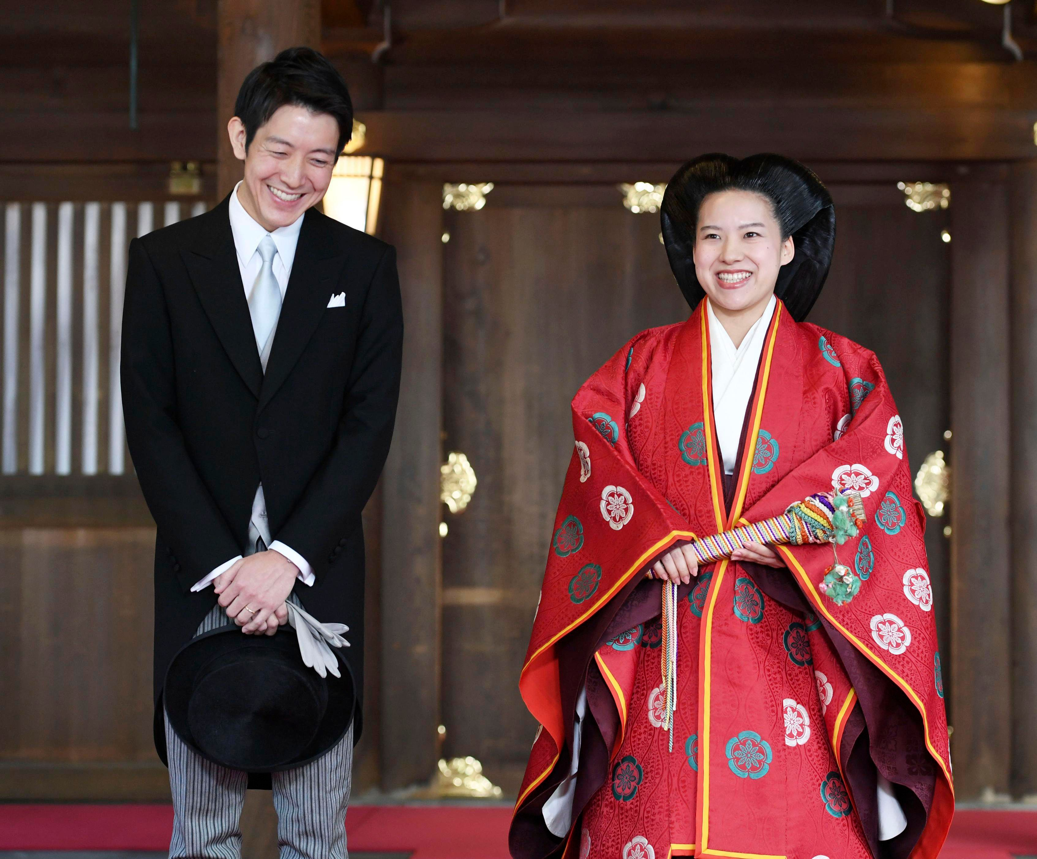 Japanese Princess Ayako, right, dressed in traditional ceremonial robe, and groom Kei Moriya, left, after their wedding ceremony at Meiji Shrine in Tokyo on Monday.