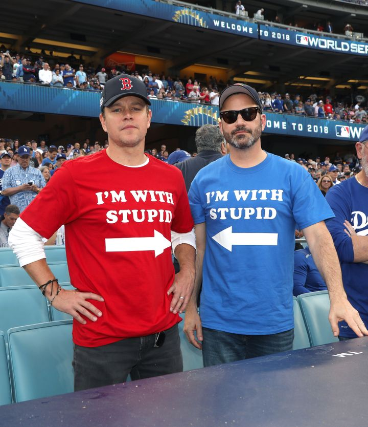 Matt Damon and Jimmy Kimmel watched the Boston Red Sox play the Los Angeles Dodgers in clashing attire Sunday.