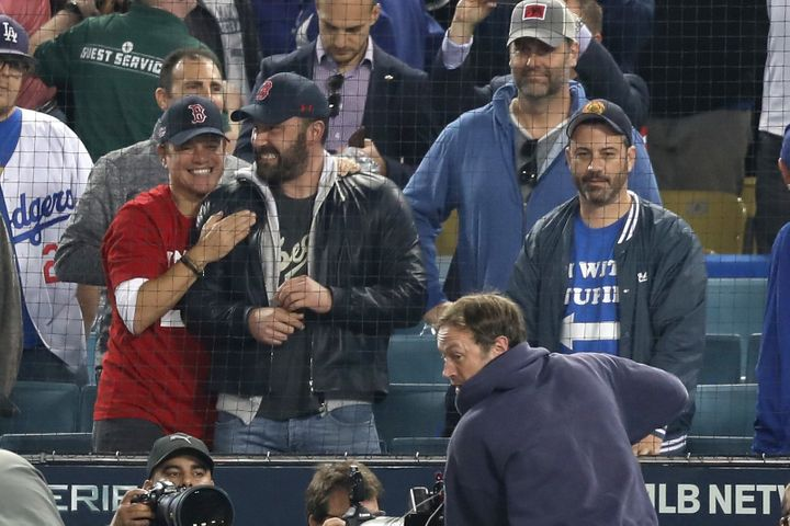 Matt Damon and Ben Affleck celebrate the Red Sox' victory while Jimmy Kimmel looks on in disappointment.