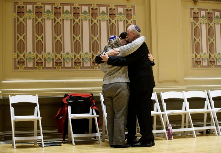 Rabbi Jeffrey Myers, right, of Tree of Life/Or L'Simcha Congregation hugs Rabbi Cheryl Klein, left, of Dor Hadash Congregatio