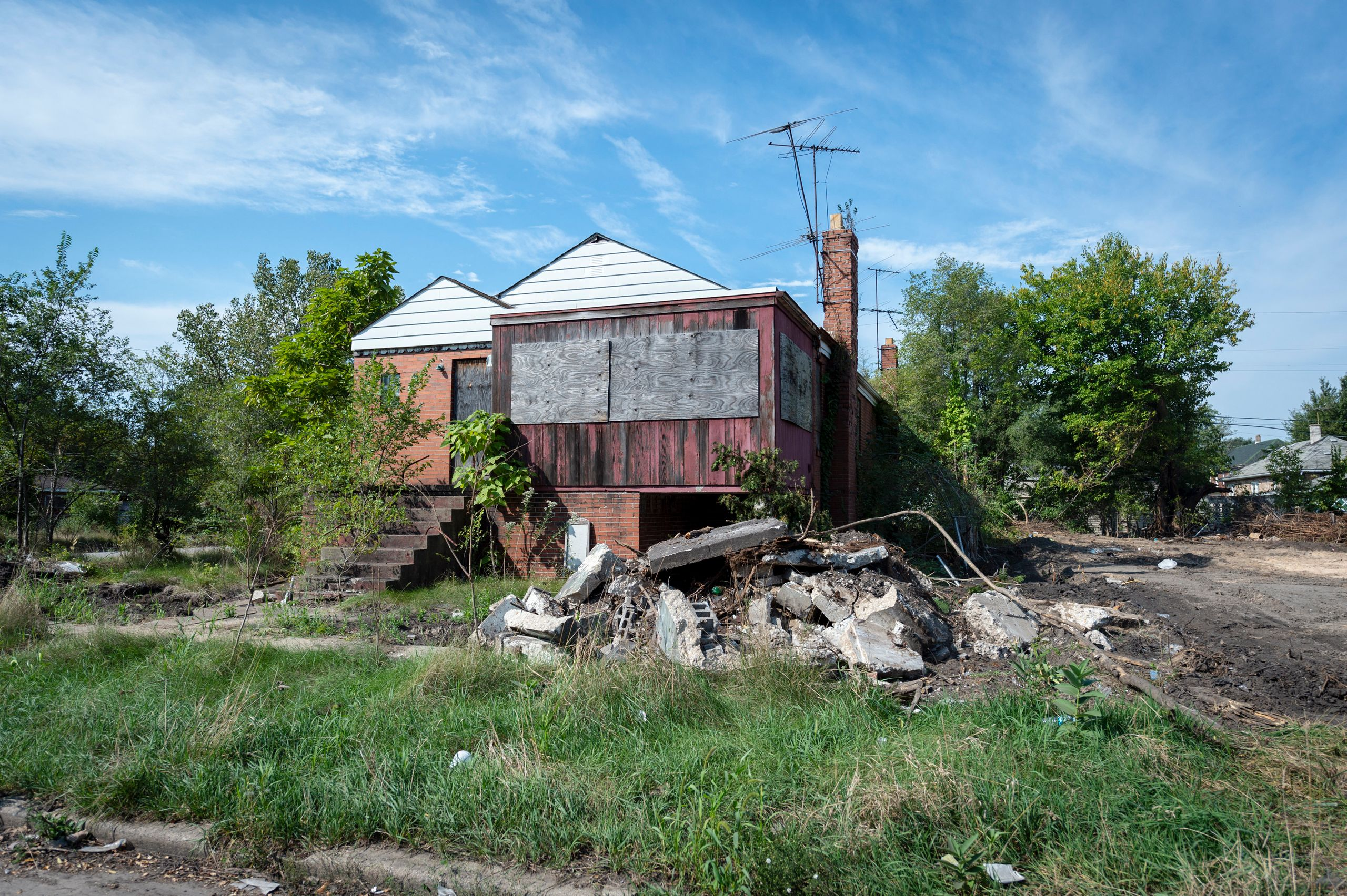 Many homes like this have been abandoned within the city.