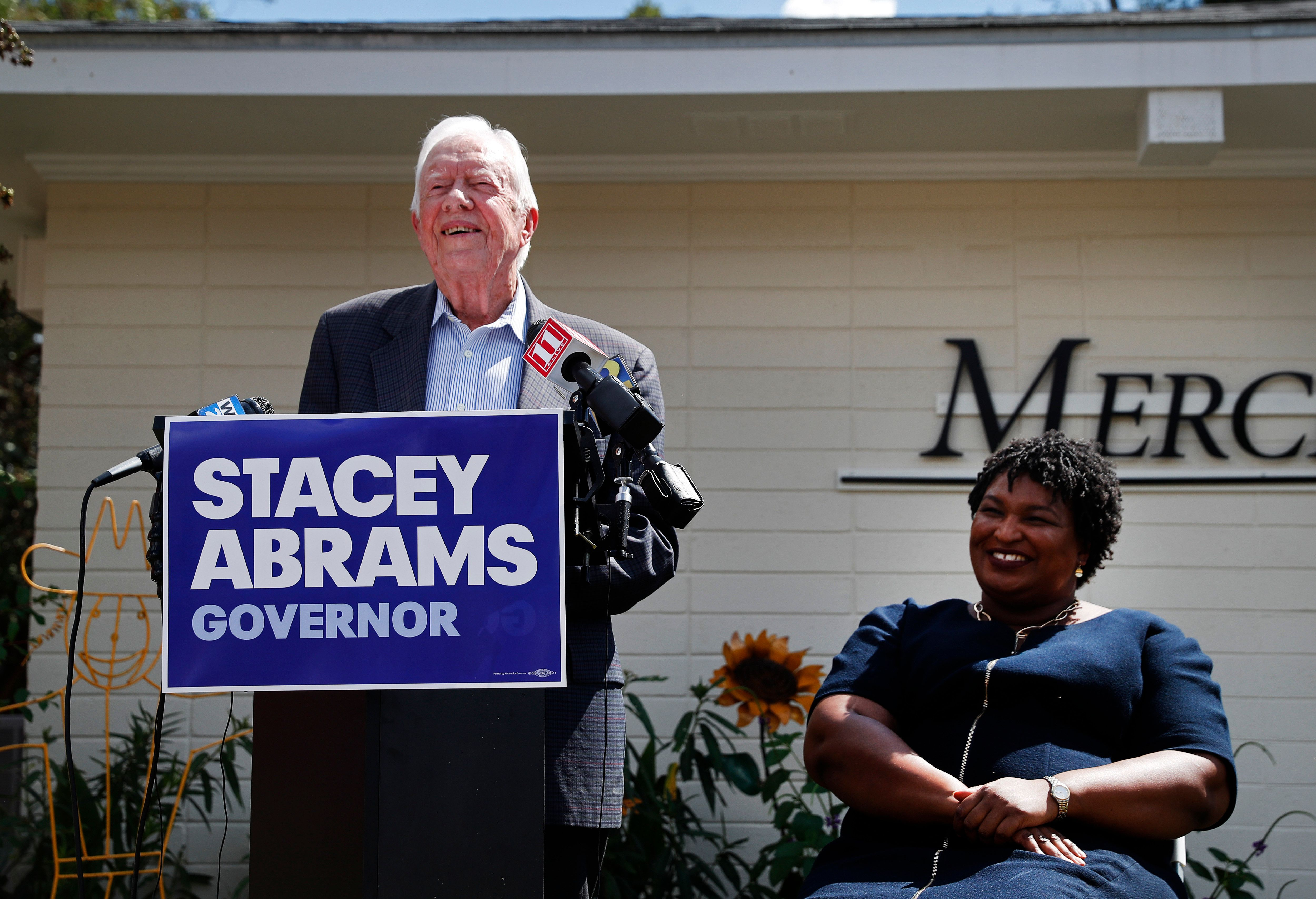 Former President Jimmy Carter (left) campaigning with Georgia's Democratic gubernatorial nominee Stacey Abrams (right).