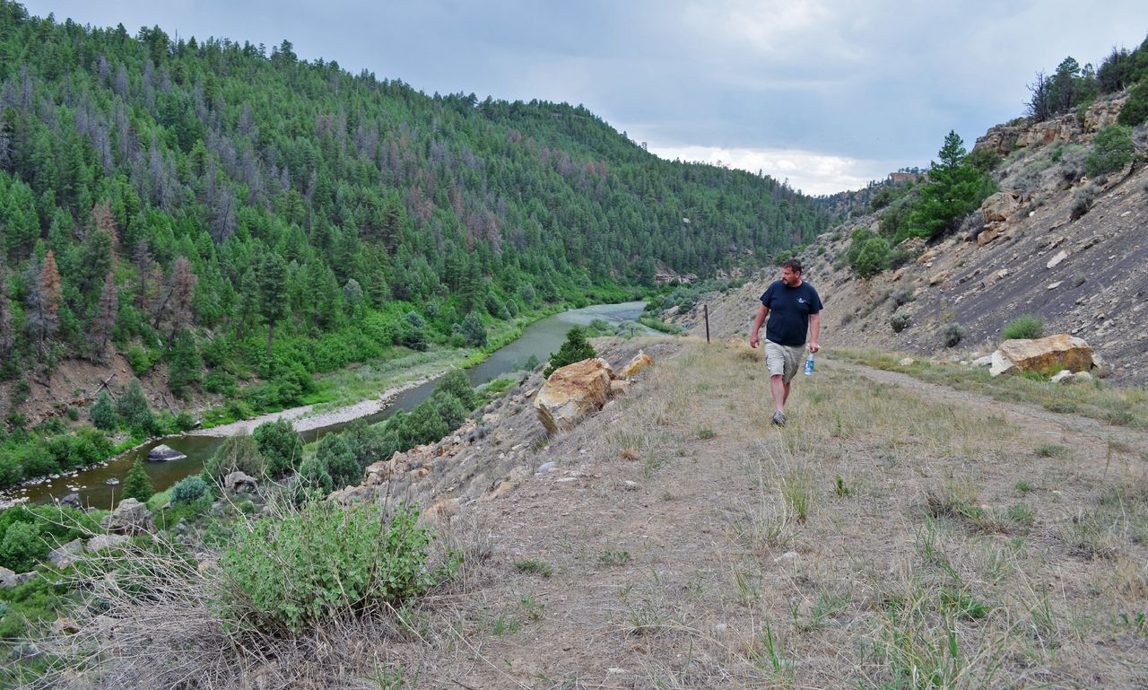 Conway walks above the Rio Chama, in Heron Lake State Park.