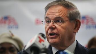 HACKENSACK, NJ - OCTOBER 17:  Surrounded by female supporters, New Jersey Senator Robert Menendez speaks at a news conference to address accusations by his Republican opponent that he slept with underage sex workers during trips to the Dominican Republic on October 17, 2018 in Hackensack, New Jersey. The claims originally emerged before Menendez was re-elected to the Senate in 2012 and despite an extensive investigation by the FBI and reporters, the accusations have never been substantiated. A million-dollar ad campaign launched on Monday by opponent, Republican Senate candidate nomineeÊBob Hugin, have used the unproven allegations against Menendez.  (Photo by Spencer Platt/Getty Images)