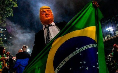 Brazil was braced for mass protests across its major cities after Jair Bolsonaro, the far-Right former army captain, secured victory in presidential elections that left the country bitterly divided.