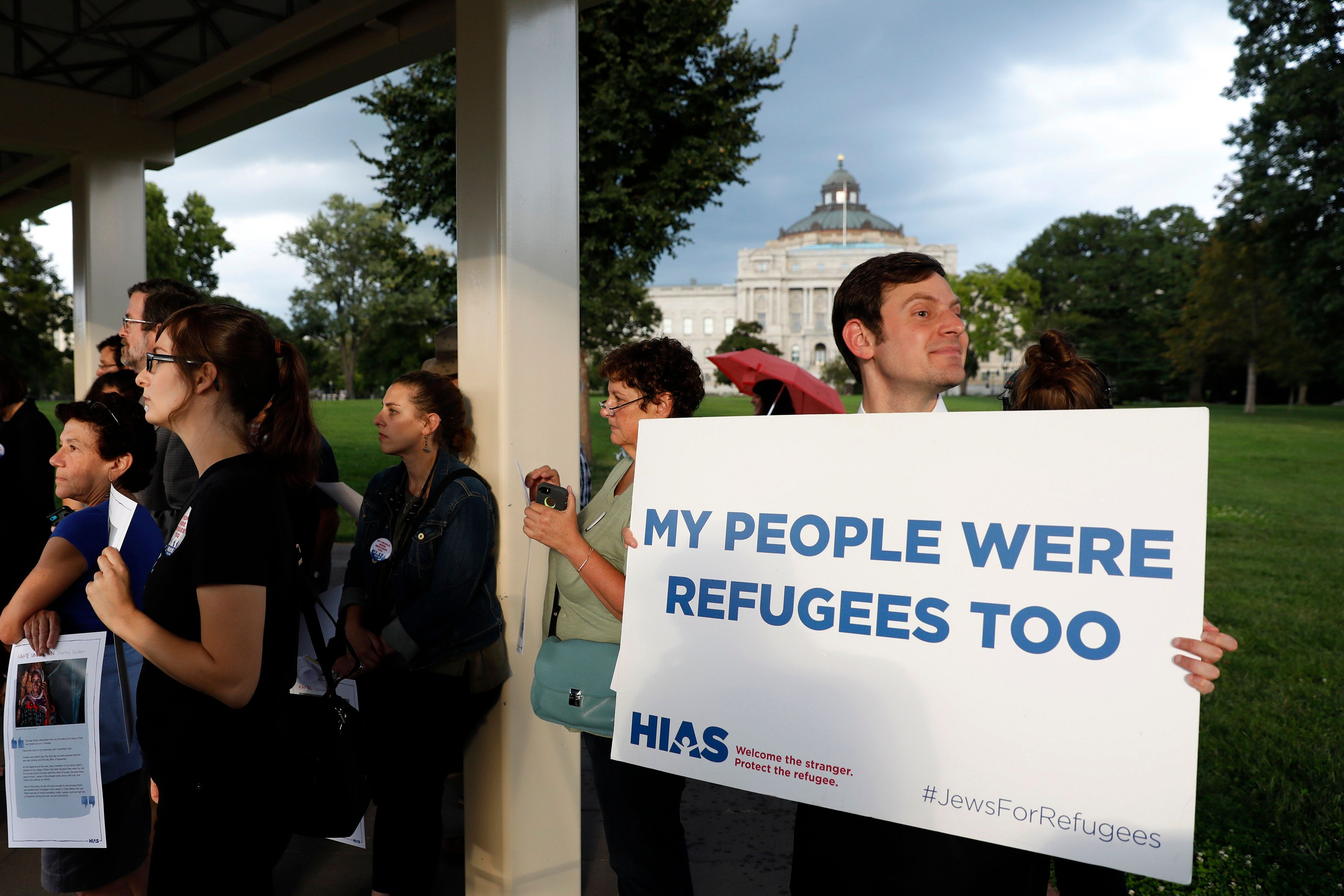 WASHINGTON, DC - SEPTEMBER 14: People holds signs during a demonstration organized by HIAS, founded as the Hebrew Immigrant Aid Society, outside the U.S. Capitol September 14, 2017 in Washington, DC. Protestors are calling on President Trump to increase the number of refugees resettled in the United States. (Photo by Aaron P. Bernstein/Getty Images)