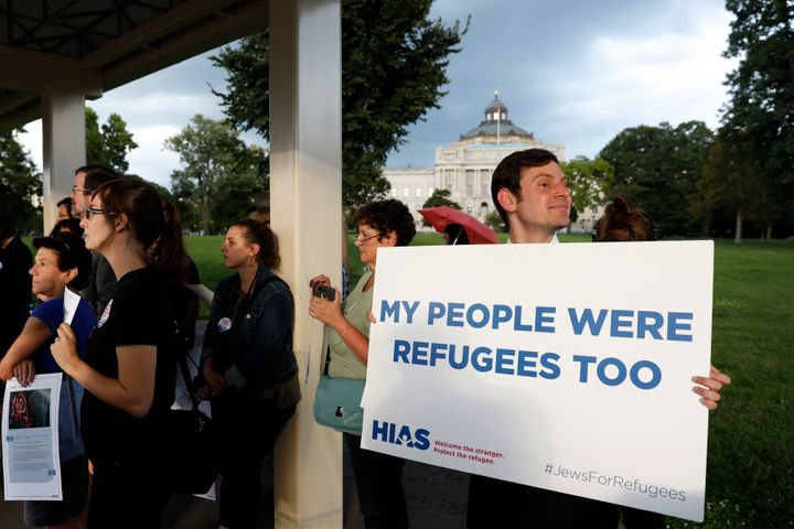 Demonstrators call on President Donald Trump to increase the number of refugees resettled in the United States in a protest o