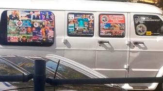 This Nov. 1, 2017, photo shows a van with windows covered with an assortment of stickers in Florida. Federal authorities took Cesar Sayoc into custody on Friday, Oct. 26, 2018, and confiscated his van, which appears to be the same one, at an auto parts store in Plantation, Fla., in connection with the mail-bomb scare that has targeted prominent Democrats from coast to coast. (Courtesy of Lesley Abravanel via AP)