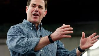 FILE - In this June 20, 2018, file photo, Arizona Gov. Doug Ducey speaks at a campaign rally in Tempe, Ariz. Ducey and his party have far outpaced Democratic challenger David Garcia in fundraising and spending in the Arizona governor's race.  (AP Photo/Matt York, File)