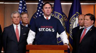 Rep. Pete Olson, R-Texas, center, with other members of the Texas delegation, speaks about the emergency funding bill for Harvey relief efforts, Wednesday, Sept. 6, 2017, during a news conference on Capitol Hill in Washington. (AP Photo/Jacquelyn Martin)