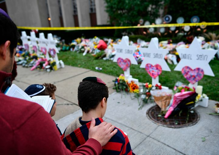 People pay their respects at a memorial outside the Tree of Life synagogue in Pittsburgh on Oct. 29, 2018.