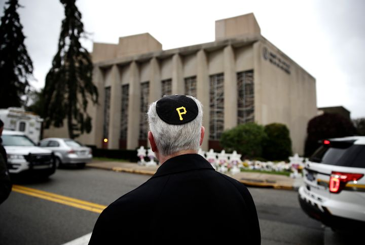 Rabbi Jeffrey Myers of the Tree of Life synagogue stands outside the house of worship on Oct. 29, 2018. He wears a yarmulke with a Pittsburgh Pirates logo.