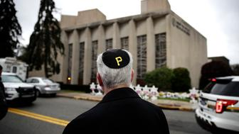 Rabbi Jeffrey Myers of the Tree of Life/Or L'Simcha Congregation stands near the synagogue and wears a yarmulke with a Pittsburgh Pirates logo, in Pittsburgh, Monday, Oct. 29, 2018. Robert Gregory Bowers, the suspect in the synagogue shooting that killed more than 10 people on Saturday is due for a court appearance on Monday. (AP Photo/Matt Rourke)