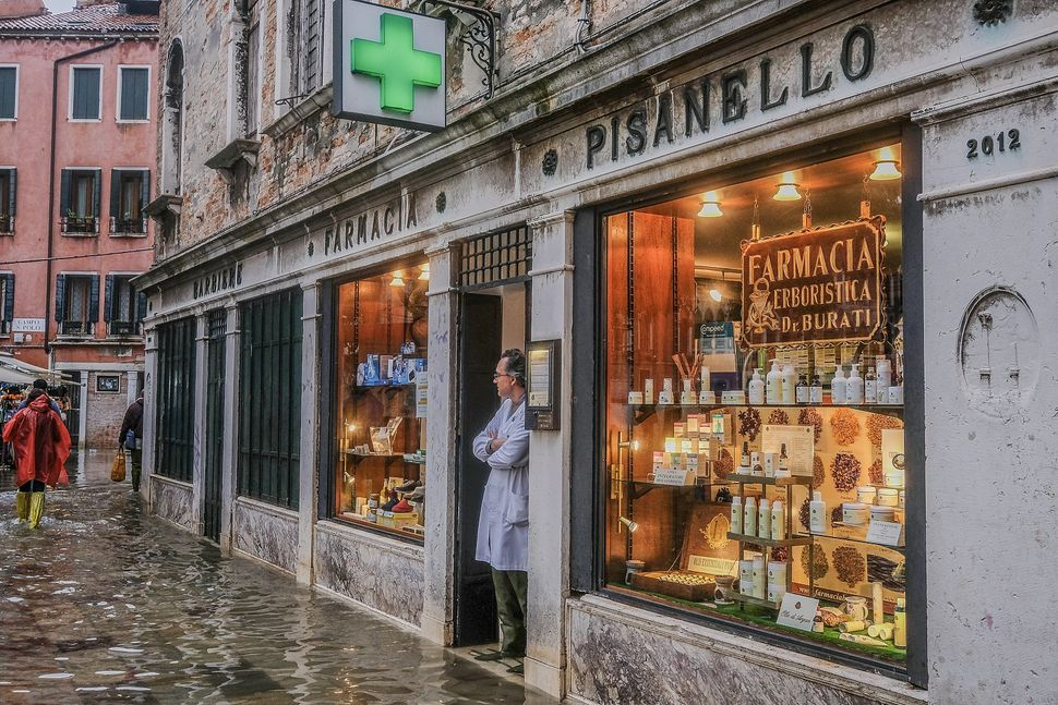 Shopkeepers and locals have become well-versed in dealing with Venice's regular flooding.