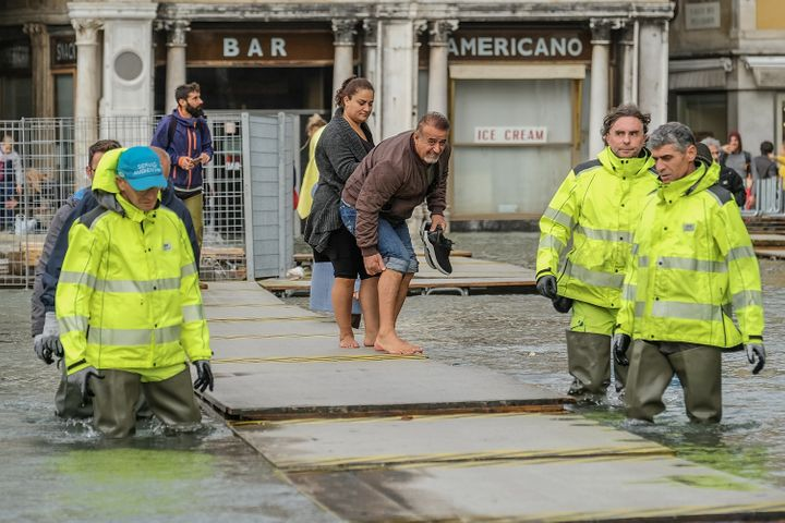 Trying to avoid the floodwaters in Venice, Italy.