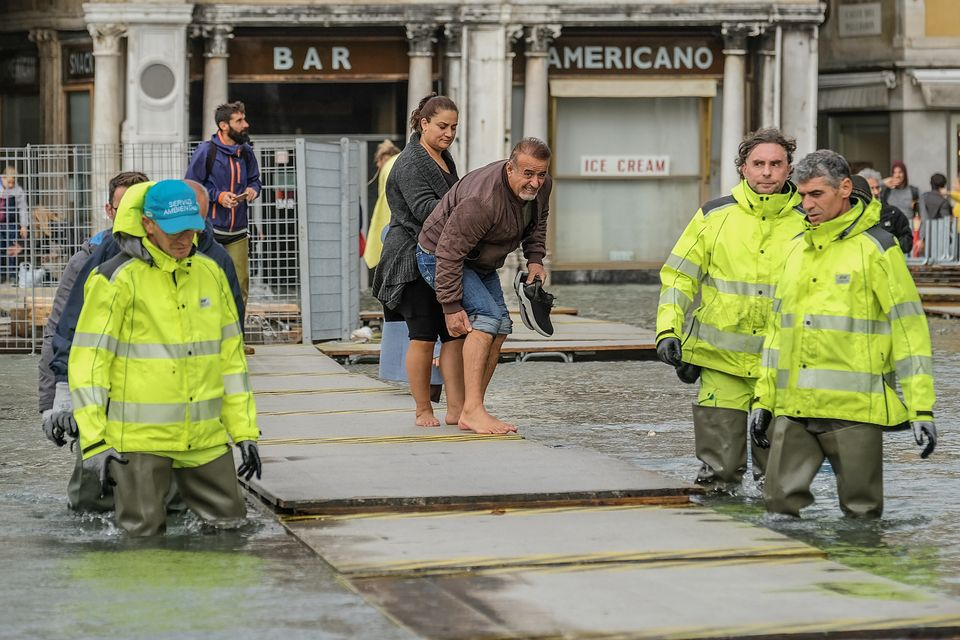 Trying to avoid the floodwaters in Venice,