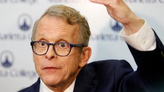 Ohio Attorney General and Republican gubernatorial candidate Mike DeWine answers reporters' questions in the spin room following a debate with Democratic gubernatorial candidate Richard Cordray at Marietta College in Marietta, Ohio, Monday, Oct. 1, 2018. (AP Photo/Paul Vernon)