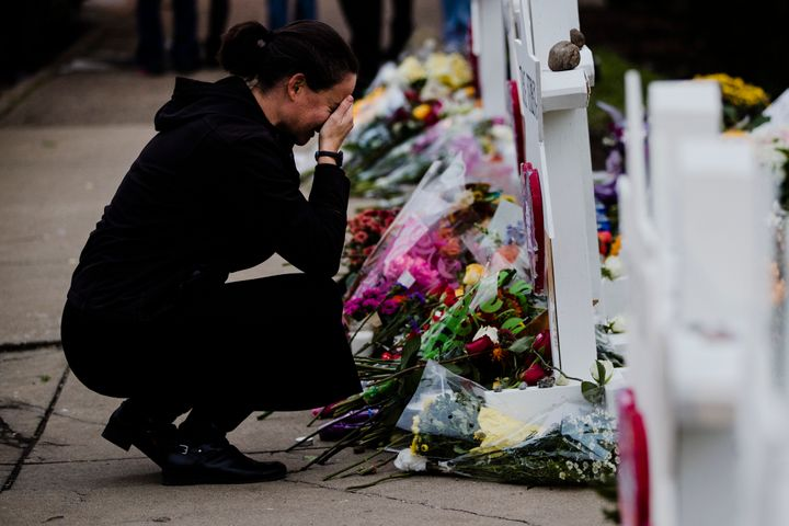 A woman pays her respects at a makeshift memorial in the aftermath of a deadly shooting at the Tree of Life Synagogue in Pitt