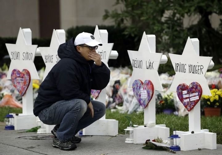A mourner pauses in front of a memorial for those killed in a deadly shooting at the Tree of Life synagogue in Pittsburgh, Oc