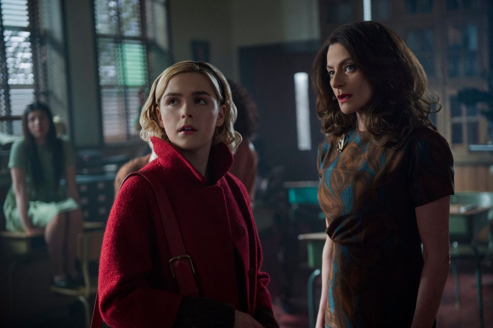 "Kiernan Shipka and Michelle Gomez in the Netflix series, ""The Chilling Adventures of Sabrina."""