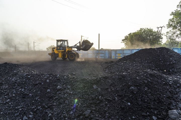 A bulldozer loads coal onto a train in Chandwa, Jharkhand, India, on Thursday, May 17, 2018.