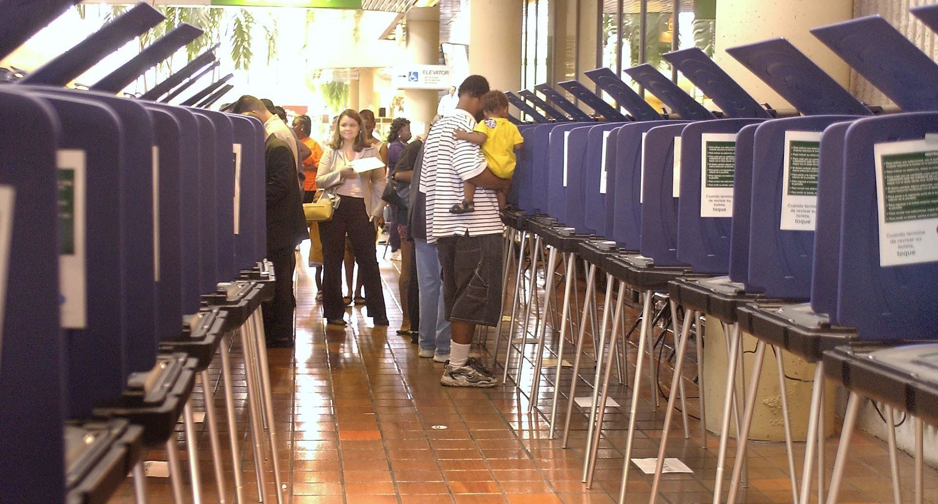 Voting booths are set up for an estimated 600-800 people in line at the Stephen P. Clark Center Monday, Nov. 1, 2004, in Miami.  (AP Photos/Mitchell Zachs)