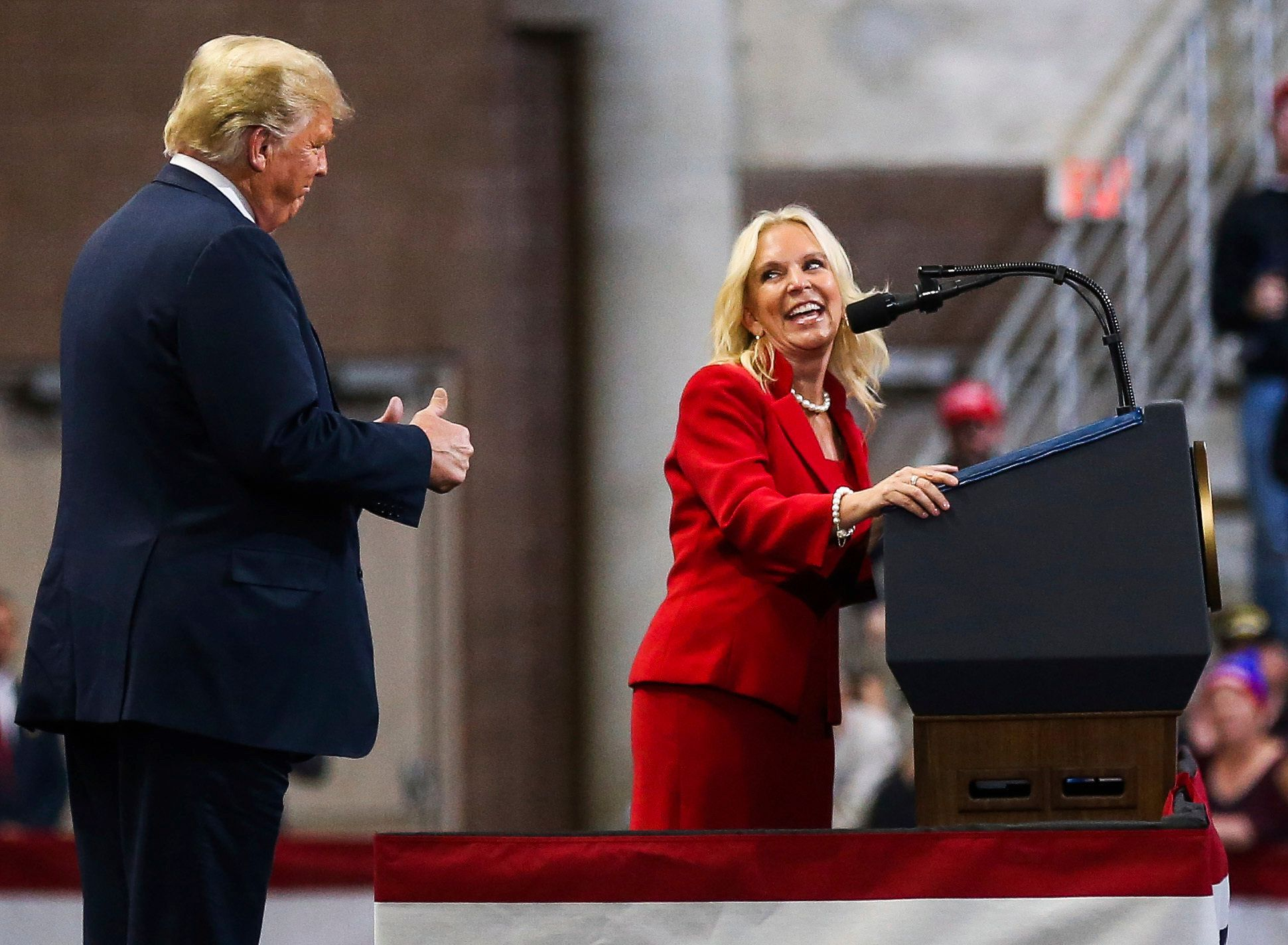 Karin Housley, a GOP candidate for the U.S. Senate, looks back at President Donald Trump while addressing the crowd during a rally, Thursday, Oct. 4, 2018, at the Mayo Civic Center in Rochester, Minn. (Andrew Link/The Rochester Post-Bulletin via AP)