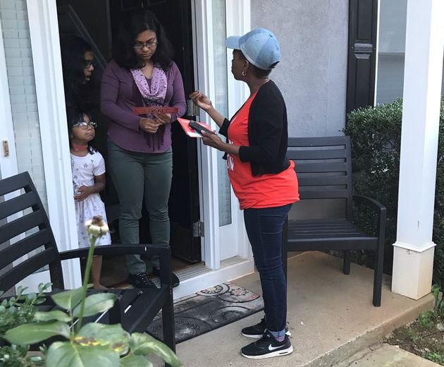 Nilaja Fabien, a 46-year-old nanny originally from Trinidad, talks to a woman in Gwinnett County, Georgia,...