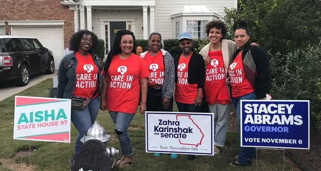 The women, domestic workers by day, canvass for Stacey Abrams in the