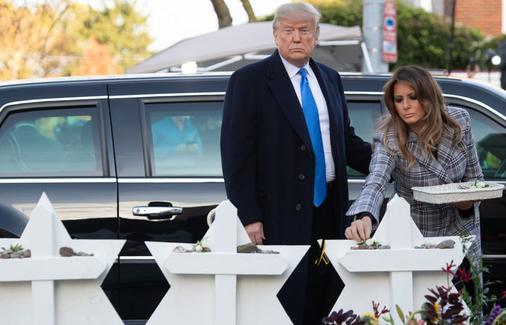 President Trump and first lady Melania Trump lay flowers on 11 makeshift Star of David memorials erected outside the syn