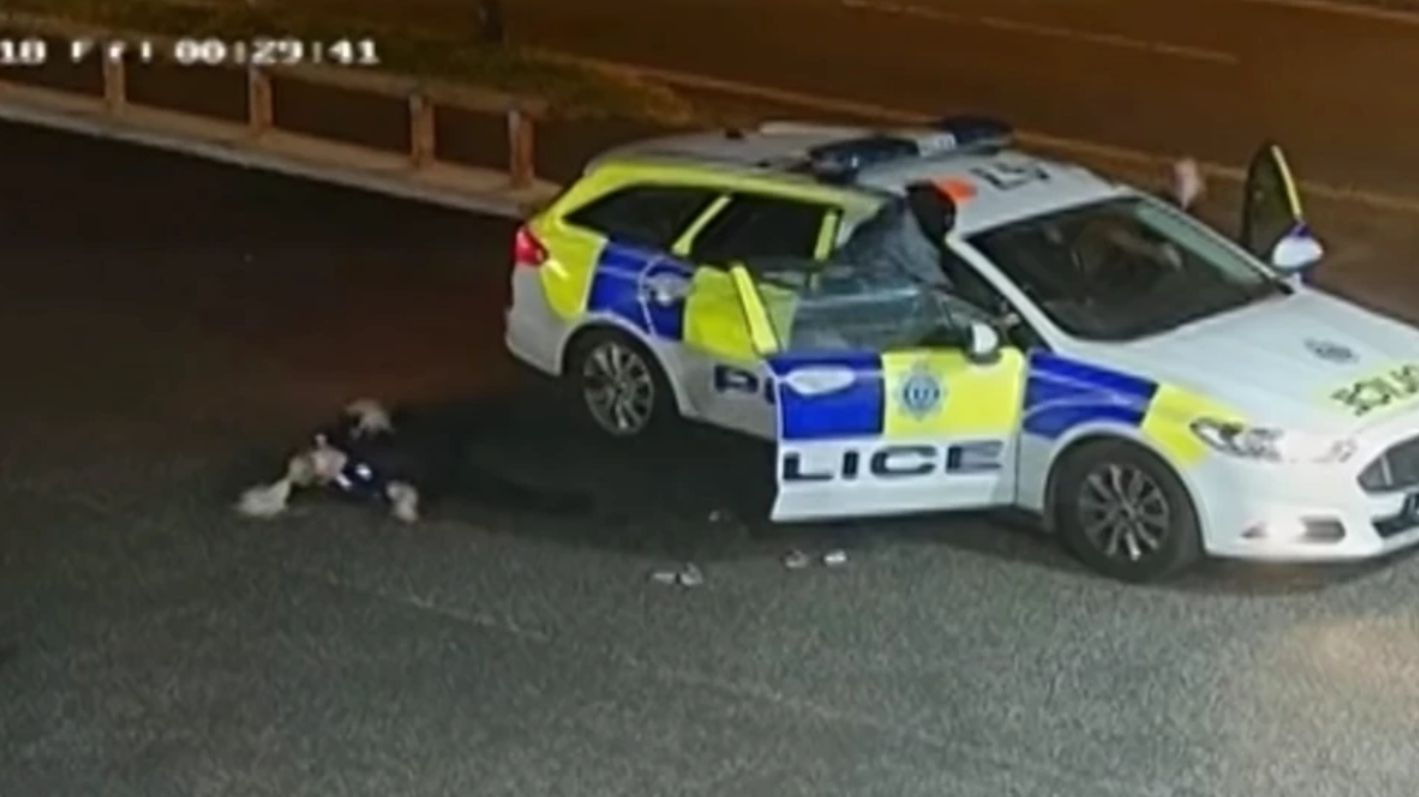 PC Ellie Young was hurled from the patrol car during the robber's failed