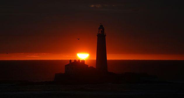 The sun rises across Whitby bay on