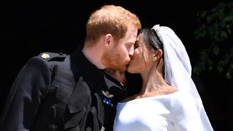 Prince Harry and Meghan Markle kiss as they leave at St. George's Chapel in Windsor Castle after their wedding ceremony.