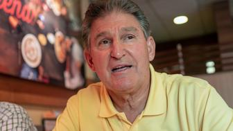 FILE- This Oct. 7, 2018 file photo shows Democrat Senator Joe Manchin in Charleston W.Va. U.S. Sen. Joe Manchin of West Virginia, facing a tough re-election in a state President Trump won by 42 percentage points in 2016, has written a series of op-ed pieces with Republican senators this week as a show of his bipartisan efforts. (AP Photo/Tyler Evert, File)