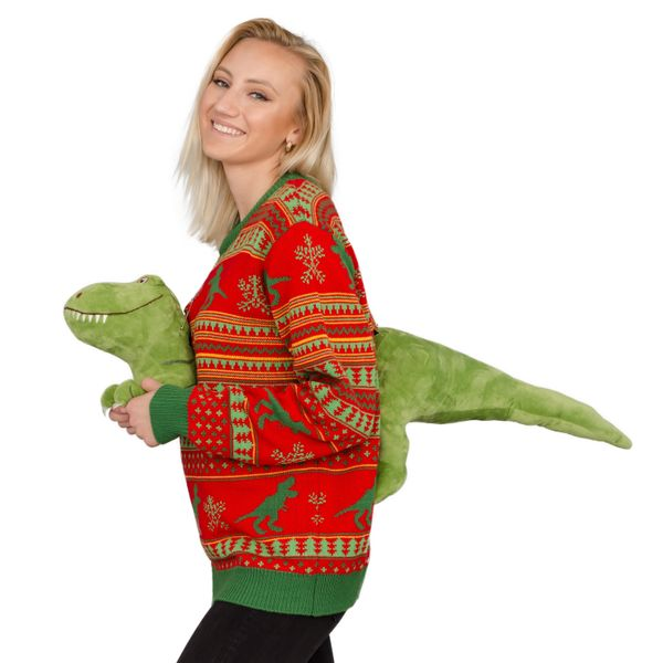 "This ugly sweater turns the holiday from Xmas to <a href=""https://www.uglychristmassweater.com/product/womens-3d-t-rex-plushi"