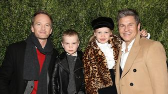 NEW YORK, NY - NOVEMBER 20: (L-R) Actor Neil Patrick Harris, Gideon Scott Burtka-Harris, Harper Grace Burtka-Harris, and actor David Burtka attend the 2017 Saks Fifth Avenue Holiday Window Unveiling And Light Show at Saks Fifth Avenue on November 20, 2017 in New York City.  (Photo by Monica Schipper/Getty Images)