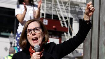 Oregon Gov. Kate Brown speaks during a rally in Portland, Ore., Oct. 17, 2018. Brown, an incumbent and one of just two female Democratic governors nationwide, has struggled to create distance between herself and her GOP rival, a state lawmaker who has fashioned himself as a moderate Republican who appeals to independents and centrist Democrats alike with his anti-Trump and pro-choice platform. (AP Photo/Don Ryan)