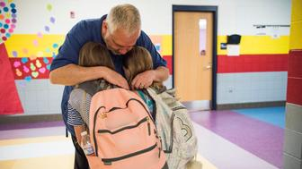 WAR, WV - JUNE 1: Students give Greg Cruey, a teacher at Southside School a hug before classes begin in War, West Virginia on June 1, 2018. (Photo by Damon Dahlen/HuffPost) *** Local Caption ***