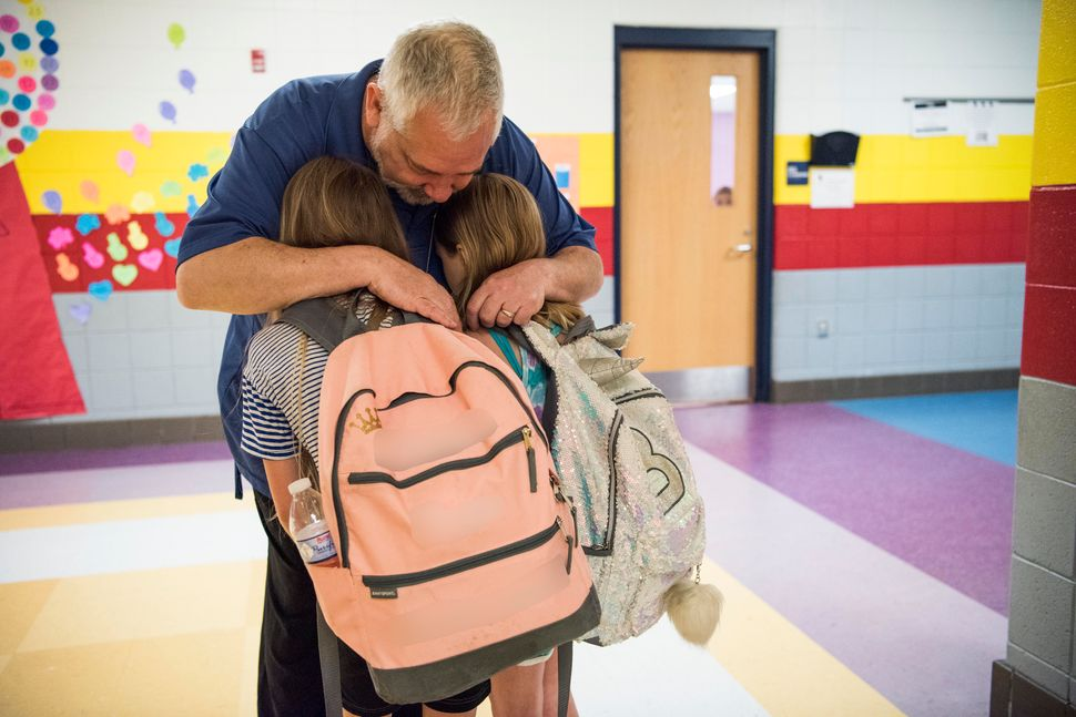 Greg Cruey, a teacher at Southside K-8 school, greeting students in the morning.&nbsp;<i>This photo has been edited to protec
