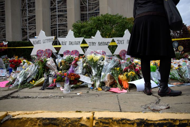 Mourners visit the memorial outside the Tree of Life Synagogue on Oct. 31, 2018 in Pittsburgh, Pennsylvania.