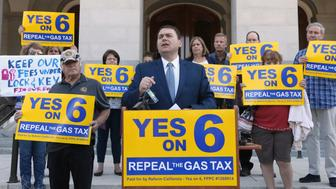 FILE - In this Sept. 25, 2018 file photo, Carl DeMaio, who is leading the Proposition 6 campaign to repeal a recent gas tax increase, discusses a ballot measure he is proposing to provide money for road repairs and eliminate high-speed rail in Sacramento, Calif. Proposition 6 seeks to repeal the 2017 decision by the Democratic-led Legislature to raise fuel taxes and vehicle fees to pay for roughly $5 billion a year in highway and road improvements and transit programs. (AP Photo/Rich Pedroncelli, File)